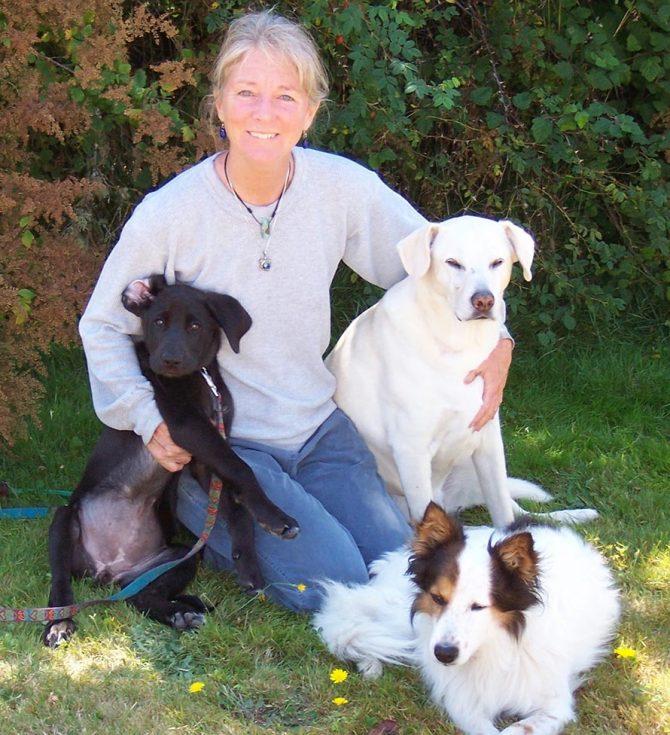Elizabeth Johnson with three dogs