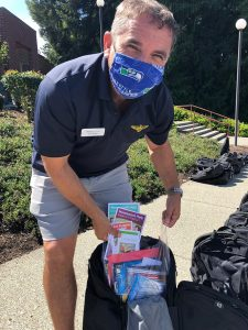 R.D. Burley shows school supplies in each backpack.