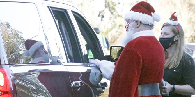 Santa Claus and a helper with Operation Homefront