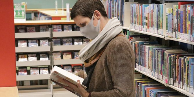 Woman browses for books in Snohomish Library